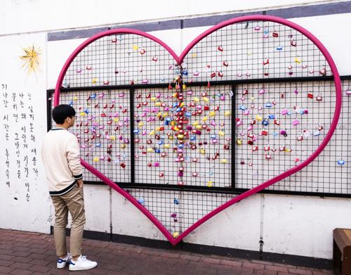 Pondering at Kim Gwangseok Memorial Street